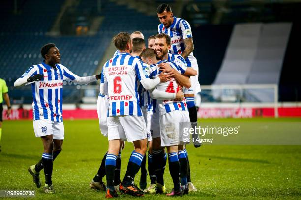 Pawel Bochniewicz of SC Heerenveen celebrates after scoring his sides second goal with his team mates during the Dutch Eredivisie match between SC...
