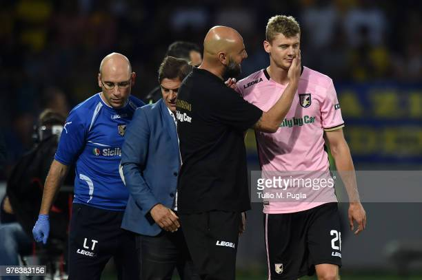 Pawel Dawidowicz of Palermo is comforted by Head Coach Roberto Stellone as he leaves the pitch after an injury during the serie B playoff match final...