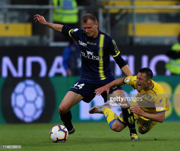 Pawel Jaroszynski of Chievo Verona competes for the ball with Camillo Ciano of Frosinone Calcio during the Serie A match between Frosinone Calcio and...