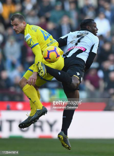 Pawel Jaroszynski of Chievo Verona competes for the ball with Stefano Okaka of Udinese Calcio during the Serie A match between Udinese and Chievo at...