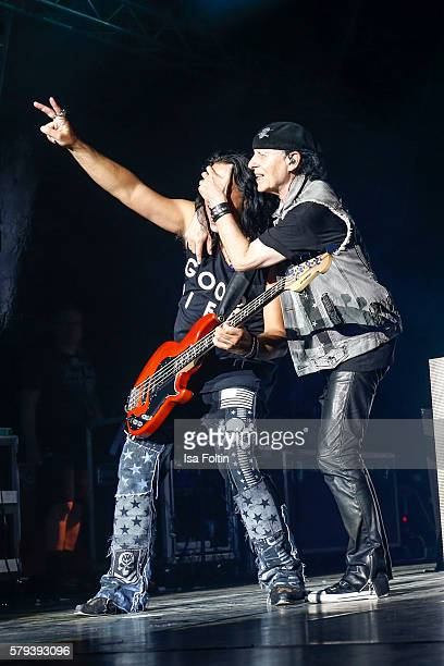Pawel Maciwoda ebass player and Klaus Meine singer of the band Scorpions perform at the Scorpions Concert during the Thurn Taxis Castle Festival 2016...