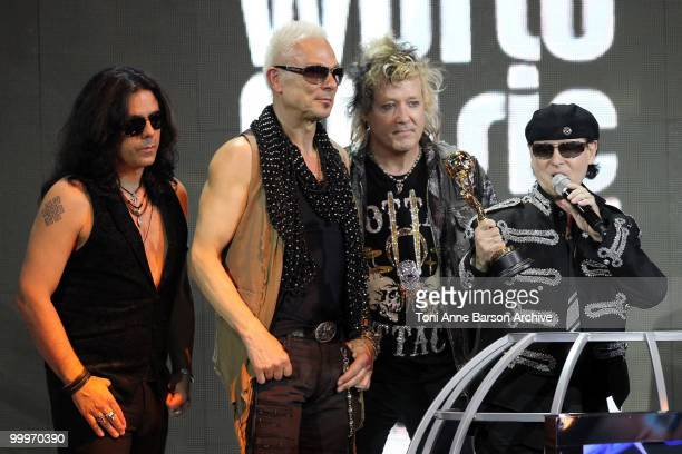 Pawel MaciwodaRudolf Schenker James Kottak and Klaus Meine perform on stage during the World Music Awards 2010 at the Sporting Club on May 18 2010 in...