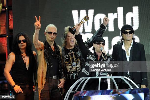Pawel MaciwodaRudolf Schenker James Kottak Klaus Meine and Matthias Jabs perform on stage during the World Music Awards 2010 at the Sporting Club on...