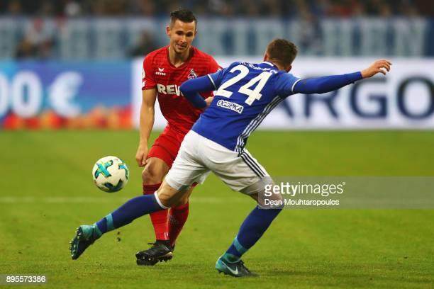 Pawel Olkowski of FC Koeln battles for the ball with Bastian Oczipka of Schalke 04 during the DFB Pokal match between FC Schalke 04 and 1 FC Koeln at...