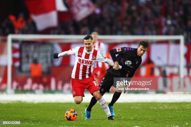 Pawel Olkowski of FC Koeln battles for the ball with Janik Haberer of SC Freiburg during the Bundesliga match between 1 FC Koeln and SportClub...