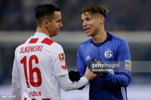 Pawel Olkowski of FC Koln Amine Harit of Schalke 04 during the German Bundesliga match between Schalke 04 v 1 FC Koln at the Veltins Arena on...