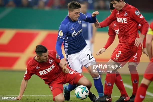 Pawel Olkowski of FC Koln Bastian Oczipka of Schalke 04 during the German DFB Pokal match between Schalke 04 v 1 FC Koln at the Veltins Arena on...