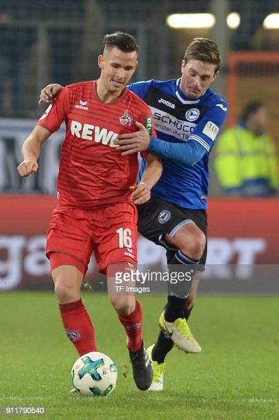 Pawel Olkowski of Koeln and Vladimir Darida of Bielefeld battle for the ball during the HHotelscom Wintercup match between Arminia Bielefeld and 1FC...