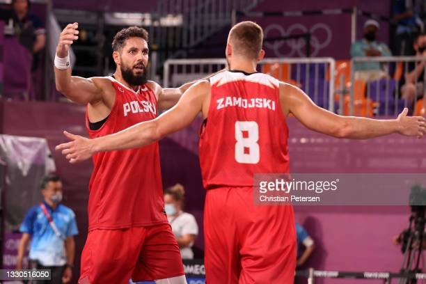 Pawel Pawlowski and Przemyslaw Zamojski of Team Poland celebrate victory after defeating Team ROC during the Men's Pool Round match between ROC and...