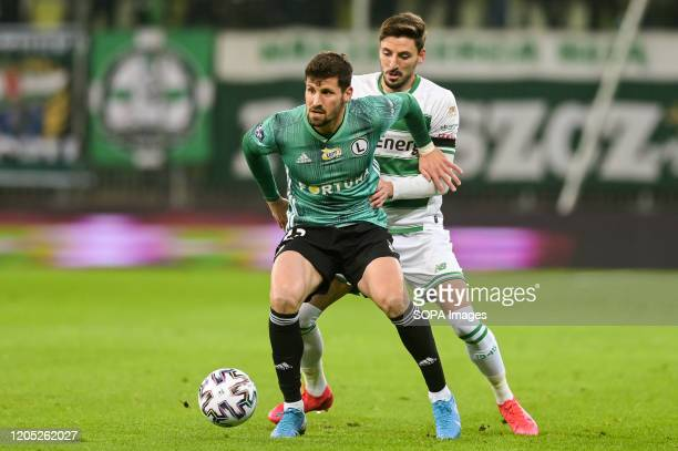 Pawel Wszolek of Legia and Filip Mladenovic of Lechia are seen in action during the Polish Ekstraklasa match between Lechia Gdansk and Legia Warsaw