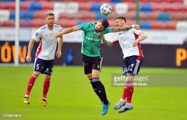 Pawel Wszolek of Legia Warszawa competes with Erik Janza of Gornik Zabrze during the PKO Ekstraklasa match between Gornik Zabrze and Legia Warszawa...