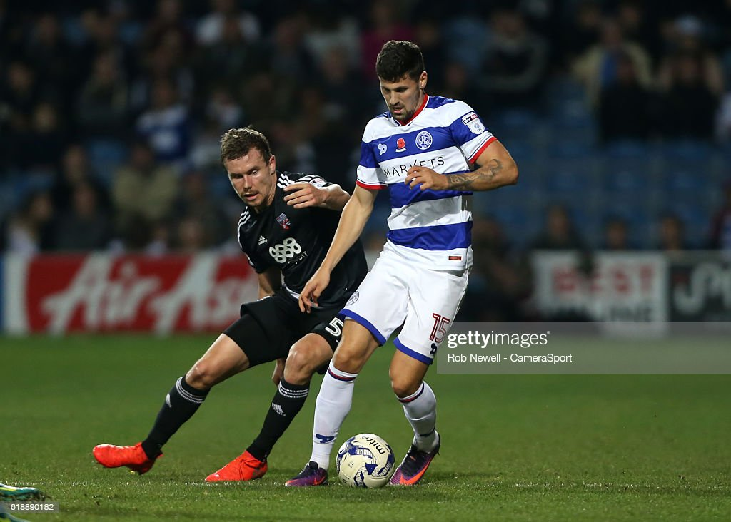 Pawel Wszolek of Queens Park Rangers and Brentford's Andreas Bjelland during the Sky Bet Championship match between Queens Park Rangers and Brentford at Loftus Road on October 28, 2016 in London, England.