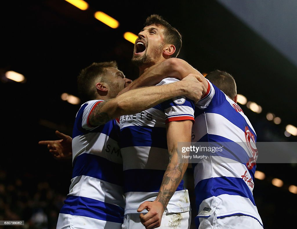 Pawel Wszolek of Queens Park Rangers celebrates scoring his teams second goal with teammates Jamie Mackie and Conor Washington during the Sky Bet Championship match between Queens Park Rangers and Ipswich Town at Loftus Road on January 2, 2017 in London, England.