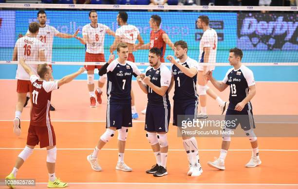 Pawel Zatorski Artur Szalpuk Fabian Drzyzga and Michal Kubiak of Poland celebrate after a point during FIVB World Championships match between Poland...