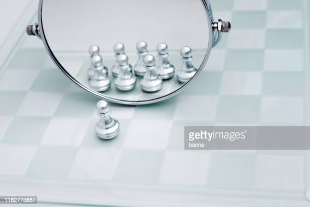 a pawn looking in the mirror - symbol stock pictures, royalty-free photos & images
