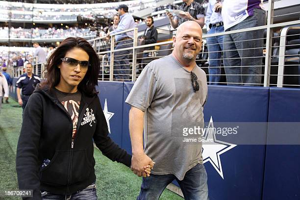 Pawn Stars star Rick Harrison walks on the field with wife Deanna Burditt prior to the game between the Minnesota Vikings and the Dallas Cowboys at...
