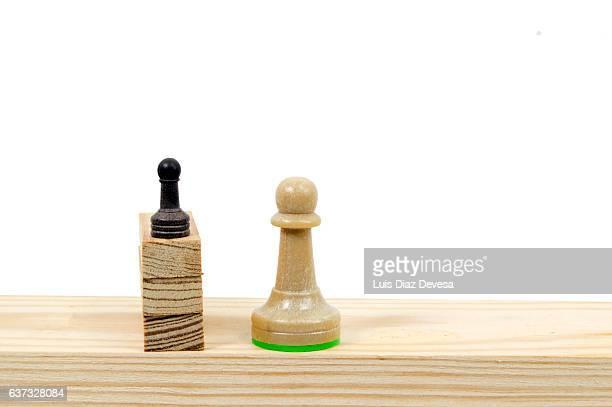 Pawns on wood blocks