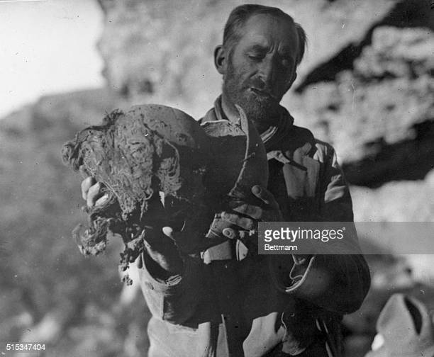 Paxson Hayes explorer is pictured with the head of one of the 7 ½ foot tall mummies he discovered while on an exploration into the wilds of the Yaqui...