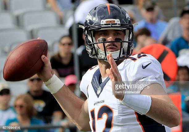 Paxton Lynch of the Denver Broncos attempts a pass against the Jacksonville Jaguars at EverBank Field on December 4 2016 in Jacksonville Florida