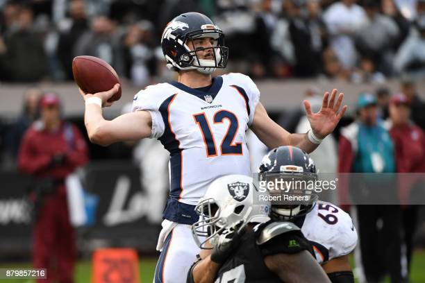 Paxton Lynch of the Denver Broncos attempts a pass against the Oakland Raiders during their NFL game at OaklandAlameda County Coliseum on November 26...