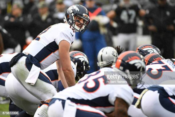 Paxton Lynch of the Denver Broncos goes under center against the Oakland Raiders during their NFL game at OaklandAlameda County Coliseum on November...