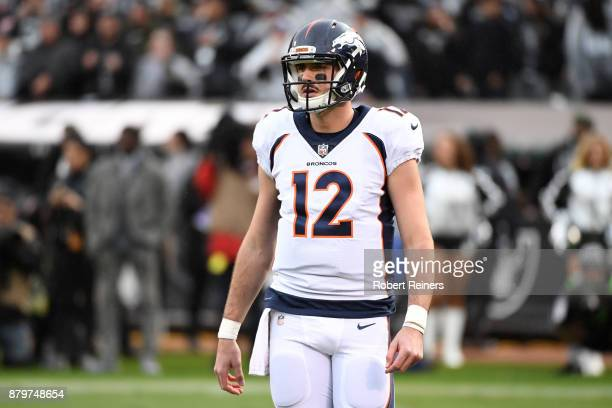 Paxton Lynch of the Denver Broncos looks on during their NFL game against the Oakland Raiders at OaklandAlameda County Coliseum on November 26 2017...
