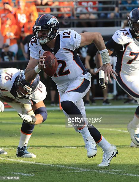 Paxton Lynch of the Denver Broncos runs for yardage against the Jacksonville Jaguars at EverBank Field on December 4 2016 in Jacksonville Florida
