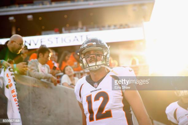 Paxton Lynch of the Denver Broncos runs on to the field to warm up for their game against the San Francisco 49ers at Levi's Stadium on August 19 2017...