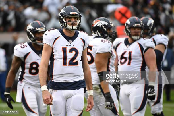 Paxton Lynch of the Denver Broncos stands on the field during their NFL game against the Oakland Raiders at OaklandAlameda County Coliseum on...