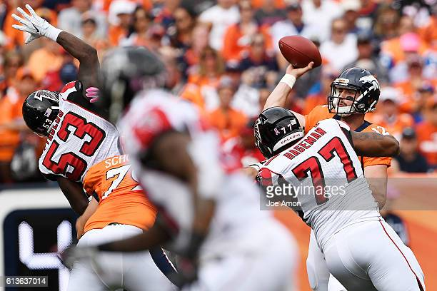 Paxton Lynch of the Denver Broncos throws as LaRoy Reynolds of the Atlanta Falcons and Ra'Shede Hageman pressure during the first quarter The Denver...