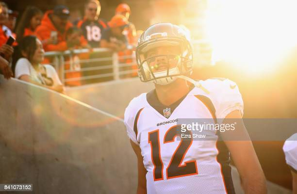 Paxton Lynch of the Denver Broncos walks on to the field for their game against the San Francisco 49ers at Levi's Stadium on August 19 2017 in Santa...