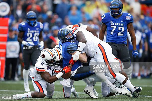 Paxton Lynch of the Memphis Tigers is sacked by Montravius Adams and Cassanova McKinzy of the Auburn Tigers in the first half of the Birmingham Bowl...