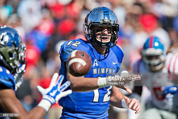 Paxton Lynch of the Memphis Tigers makes a pitch to the running back during a game against the Ole Miss Rebels at Liberty Bowl Memorial Stadium on...