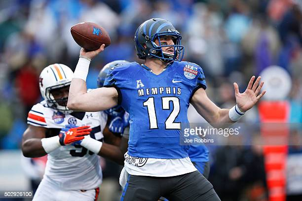 Paxton Lynch of the Memphis Tigers passes against the Auburn Tigers in the first half of the Birmingham Bowl at Legion Field on December 30 2015 in...