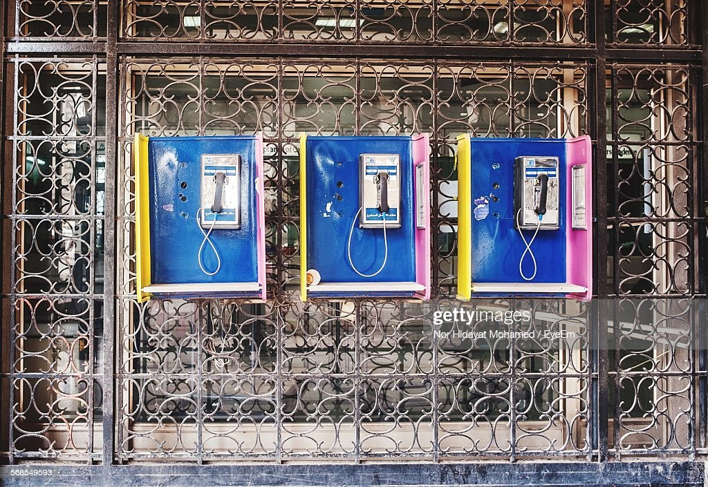 Pay Phones On Metal Grate : Stock Photo