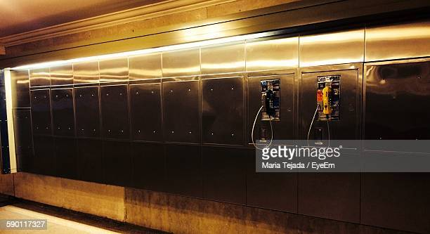 pay phones on metallic wall - maria tejada stock pictures, royalty-free photos & images