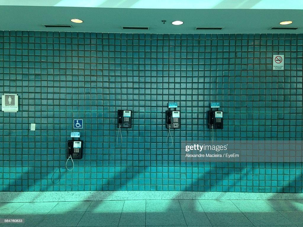 Pay phones with information symbols on wall stock photo getty images pay phones with information symbols on wall stock photo biocorpaavc