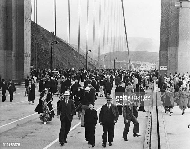 Pay to walk and Like It Some of the thousands of guests who walked across the Folden Gate Bridge San Francisco Cal when it was opened to the...