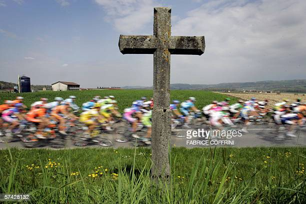 Racers ride behind a Christian cross during the stage Payerne to Payerne a 169km loop at the sixday Tour of Romandie UCI Protour cycling race 26...