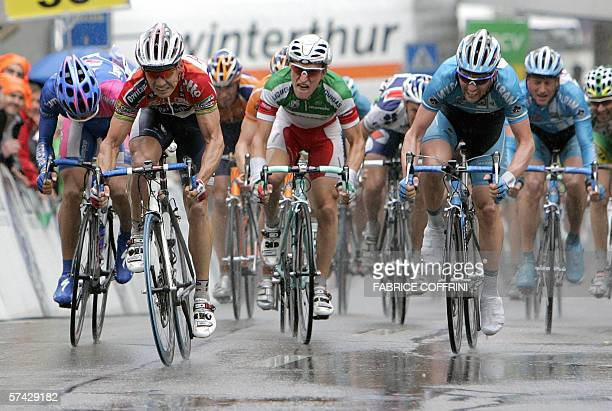 Winner of the stage Robbie McEwen of Australia fights during the sprint with second Mirco Lorenzetto of Italy at the first stage Payerne to Payerne a...