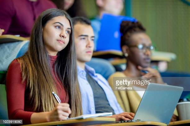 paying attention in class - college student stock pictures, royalty-free photos & images