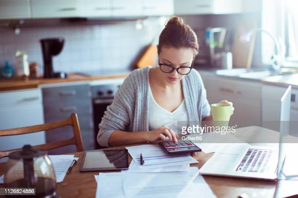 paying bills - calculator stock pictures, royalty-free photos & images