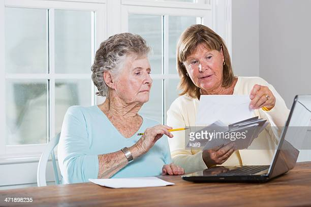 paying bills - carers stock photos and pictures