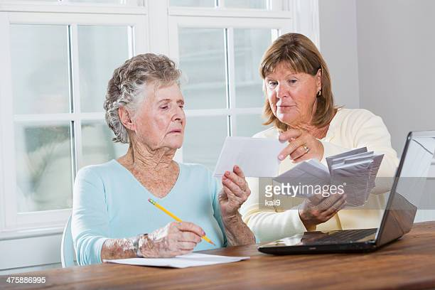 paying bills - grandma invoice stock pictures, royalty-free photos & images