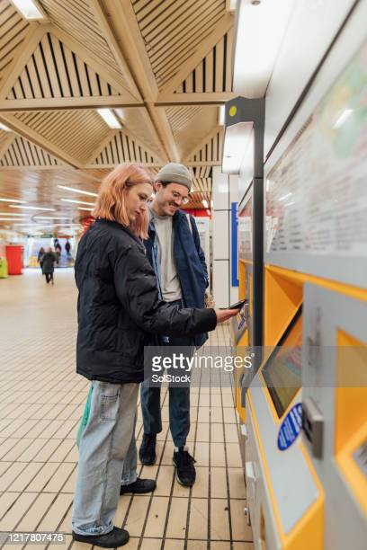 paying contactless for subway tickets - newcastle stock pictures, royalty-free photos & images