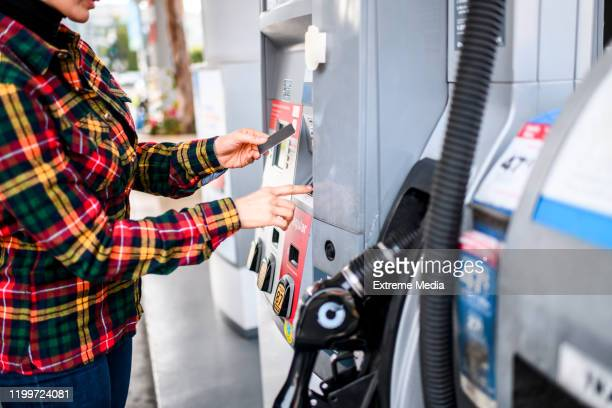 paying for gas - paying stock pictures, royalty-free photos & images