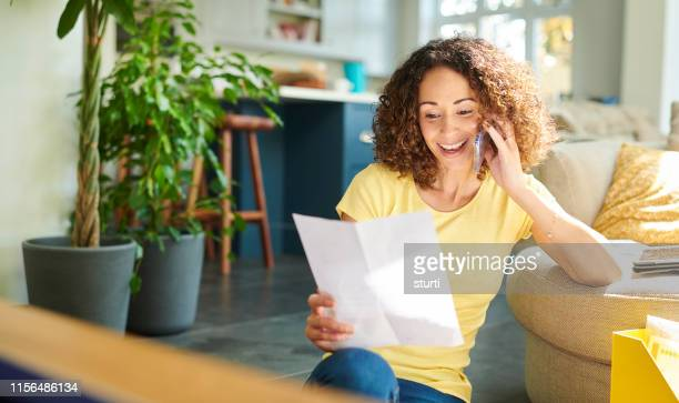 paying her bill by phone - using phone stock pictures, royalty-free photos & images