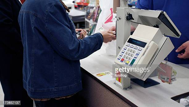 paying - convenience store counter stock photos and pictures