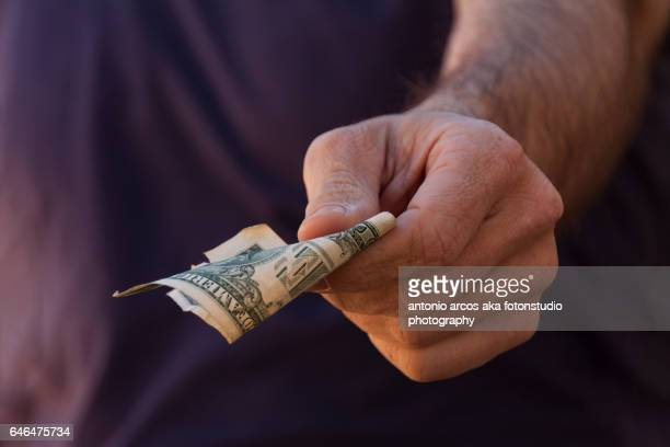 paying - commercial activity stock photos and pictures