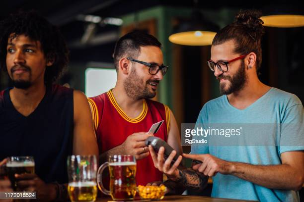 paying the bill with a credit card - charging sports stock pictures, royalty-free photos & images